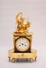 A fine French patinated and gilt bronze mantel clock, circa 1800