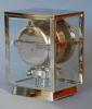 M203 Nickel plated art deco J. L. Reutter four-glass Atmos clock.