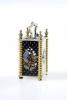 A decorative miniature carriage clock, 8 day,  enamel, Melik Watch Co. Fab. Suisse, circa 1920.