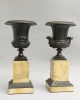 Bronze Medici vases on marble bases