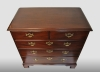 English solid mahogany chest of drawers with beautiful original drawer pulls.