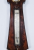 An imposing king size wheel barometer by