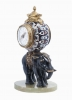 Cute miniature time piece pendulum of a bronze elephant carrying the movement