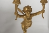 A pair of two armed empire ormolu candlestick with Cupids, Circa 1820