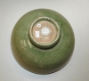 Chinese celadon stoneware bowl with impressed design on the interior.