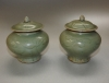Pair of Chinese celadon stoneware small jars and covers with carved decoration