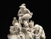 An ivory elephant with attendants