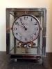 M211 Nickel plated art deco J. L. Reutter four-glass Atmos clock