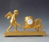 Attractive small mantel clock / pendulette, Amor  with wheelbarrow, Austria circa 1810.