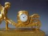 Attractive small mantel clock / pendulette, Amor  with wheelbarrow, Austria circa 1810.