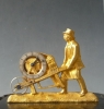 Austrian pendulette, bronze sculpture, man with wheelbarrow, Vienna circa 1840.