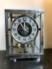 M233 Nickel plated art deco J. L. Reutter four-glass Atmos clock.