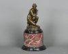 A lovely classic bronze figure on a kneeling Venus mounted on the marble base