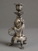 An unusual Silvered candle stick of an old man as fantasy figure, circa 1880
