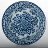 A Deep Charger in Dutch Delftware with a Flower Decoration