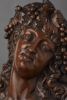 A French walnut carved bust of Bacchante, circa 1830