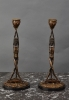 An unusual pair of Art Deco candlesticks featuring Satyrs