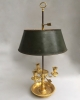 An Empire ormolu bouillotte lamp