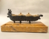 Bronze boat as ink set on marble pedestal
