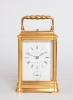 A French gilt brass gorge case carriage clock, Henri Jacot, circa 1870