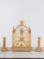 An unusual French Louis XVI filigree skeleton clock set, circa 1780