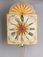 A German Wall Clock with 'cow's-tail pendulum' and wooden wheels circa 1800