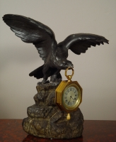 An eagle shaped bronze watch stand and clock watch with quarter repetition