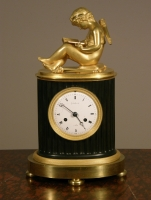 A small French Empire patinated and ormolu sculptural mantel clock Grandperrin à Perrin circa 1805.