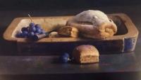 Still-life, sugared bread with blue grapes