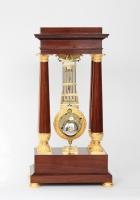 A French mahogany oscillating portico mantel clock, circa 1825