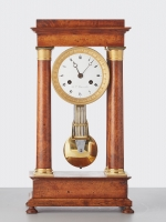 A French 'Empire' maple and gilt 4-column clock, circa 1830