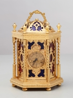 A very unusual hexagonal English 'Gothic Revival' travelling clock by Howell James, circa 1870