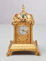 An important English 'tabernacle' miniature travelling clock, circa 1860