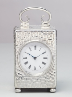 A small English silver travelling clock, circa 1900, by William Comyns