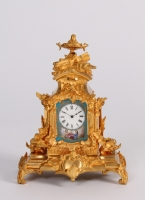 A miniature French Napoleon III Sèvres mounted gilt bronze mantel timepiece, circa 1870