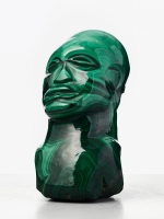 An malachite sculpture of an African man, circa 1970