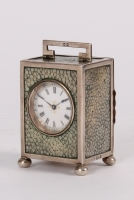 An attractive miniature English silver carriage timepiece with rayskin hallmarked 1924