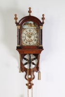 An attractive Dutch Frisian maddered oak striking alarm 'staartschippertje'wall clock, circa 1830.