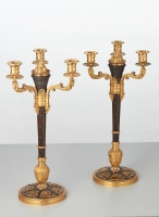 A rare pair of European four-light gilt bronze 'Directoire' candlesticks, circa 1810
