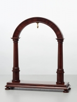 An elegant walnut contemporary custom made stand for displaying a watch