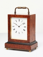 An elegant French burr-walnut 'time-piece' travelling clock, circa 1840