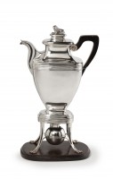 Silver coffee pot on chafing dish