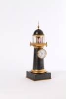 A small and amusing French bronze and gilt lighthouse timepiece with visible balance, circa 1850