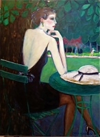 Lady in the parc, sitting at a round table