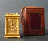 A French miniature carriage clock with two portraits, circa 1880.