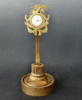 A French rack clock under glass dome on gilded base, Louis Seize, Alsace circa 1780.
