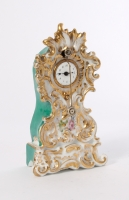 A small French polychrome porcelain so-called 'Zappler' timepiece, by Jacob Petit, circa 1850