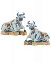 Pair of Polychrome Figures of Recumbent Cows in Dutch Delftware
