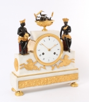 A rare French 'Directoire' marble and ormolu mounted 'au bon Sauvage' mantel clock, circa 1800