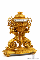 A French gilt bronze sculptural cercles tournants mantel clock, Deniere, circa 1860